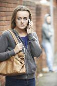 foto of she-male  - Teenage Girl Feeling Intimidated As She Walks Home - JPG
