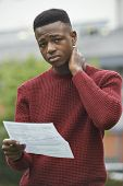 stock photo of disappointed  - Portrait Of Teenage Boy Disappointed With Exam Results - JPG