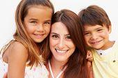 stock photo of cheeky  - Portrait Of Hispanic Mother With Children - JPG