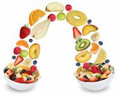 picture of fruit bowl  - Flying fruit salad in bowl with fruits like apples oranges kiwi grapes peach banana and strawberry - JPG