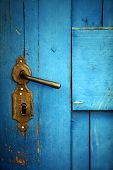 picture of door-handle  - Color shot of a vintage door handle on a wooden blue door - JPG