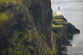 stock photo of lighthouse  - Coastline landscape in Skye isle with lighthouse - JPG