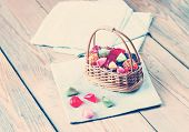image of candy  - Basket with colorful sweet candies in a vintage style - JPG