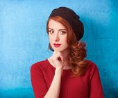 picture of beret  - Redhead women in beret on blue background - JPG