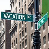 pic of sabbatical  - A sign post at the intersection of two streets reading VACATION DR and BEACH ST - JPG