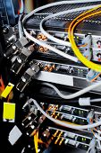 picture of telecommunications equipment  - Telecommunication equipment of network cables in a datacenter of mobile operator - JPG