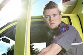image of paramedic  - Paramedic employee with ambulance in the background - JPG
