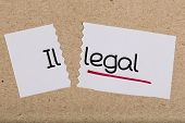stock photo of illegal  - Two pieces of white paper with the word illegal turned into legal - JPG