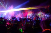 stock photo of sticks  - Color neon streaks of light glow sticks at a night celebration and rave - JPG