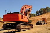 picture of track-hoe  - Large track excavator being delivered to a construction site on a low - JPG