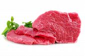 stock photo of boeuf  - Cut of beef steak with green leaf - JPG