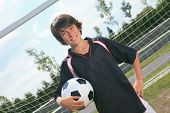 stock photo of 13 year old  - A soccer player on the play field - JPG