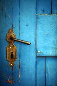 stock photo of door-handle  - Color shot of a vintage door handle on a wooden blue door - JPG