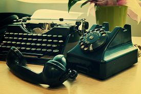 image of outdated  - Vintage phone and old typewriter  - JPG
