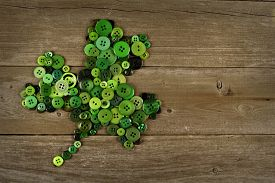 foto of shamrocks  - St Patricks Day shamrock made of buttons against an old wood background - JPG