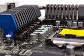 stock photo of processor  - Multiphase power system modern processor with heatsink and the CPU socket - JPG