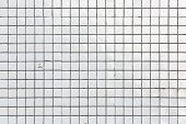 pic of ceramic tile  - Old white obsolete and damaged tiled wall as a texture or background - JPG