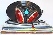 pic of lp  - Headphones resting on a stack of vinyl used - JPG