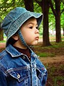 picture of panama hat  - Portrait of a baby boy in a denim jacket and a panama hat on the street at evening - JPG