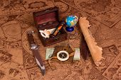 foto of treasure map  - Old compass lying on antique map with treasure chest - JPG