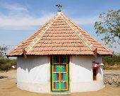 picture of threshing  - Traditionally decorated hut in the tribal village on the desert in India in the Gujarat state - JPG