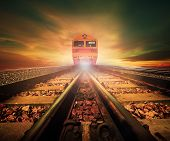 image of train track  - trains on junction of railways track in trains station agains beautiful light of sun set sky use for land transport and logistic industry theme - JPG