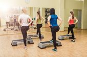 picture of step aerobics  - Group of women making step aerobics in fitness club  - JPG