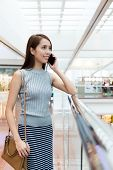 stock photo of department store  - Woman talk to mobile phone at department store - JPG