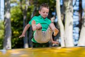 picture of bouncing  - Young caucasian boy in Denmark on a summer day - JPG