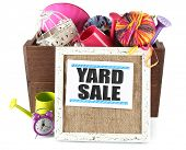 image of yard sale  - Box of unwanted stuff ready for yard sale isolated on white - JPG