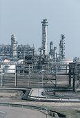 foto of chimney  - Industrial landscape with chimneys tank - JPG