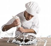 picture of pastry chef  - Pastry chef decorates a cake with cream - JPG