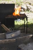 foto of blacksmith shop  - Vise and anvil in a forge shop - JPG