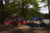picture of nylons  - Two nylon tents in a campsite next to a big lake - JPG