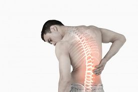 pic of spine  - Digital composite of Highlighted spine of man with back pain - JPG