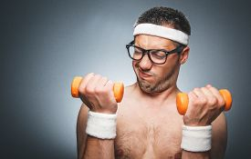 stock photo of nacked  - Portrait of a nerd guy trains with dumbbells - JPG