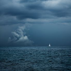picture of sailing vessels  - Boat Sailing in Center of Storm Formation - JPG
