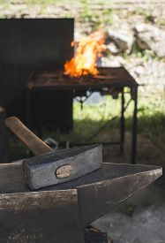 stock photo of anvil  - Vise and anvil in a forge shop - JPG