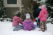 pic of children playing  - little kids making a snow balls for a fight - JPG