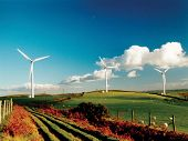 stock photo of wind-turbine  - wind turbines on a farm - JPG