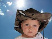 stock photo of baby cowboy  - an adorable baby wearing a cowboy style hat - JPG