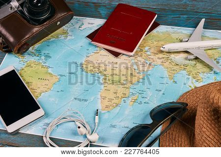 poster of Passport, Photo Camera, Smart Phone, Sunglasses, Straw Hat And Travel Map, Traveler Items Vacation T