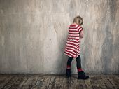 A Punished Child Standing By The Wall. poster