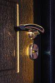 Wooden Door With Stainless Door Knob Or Handle On Dark Wooden Door In Beautiful Lighting poster