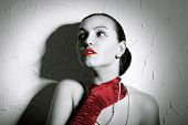 Beauty Fashion Glamorous Model Female Portrait. Vintage Style Mysterious Woman Wearing Red Glamour G poster