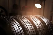 Car tires in automobile service center, closeup poster