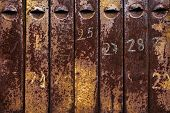 old rusty iron mailboxes. poster