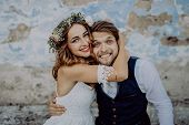 Beautiful Young Bride And Groom Outside In Front Of An Old Shabby House. poster