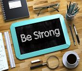 Small Chalkboard With Be Strong. Be Strong. Business Concept Handwritten On Mint Small Chalkboard. T poster