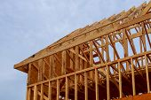 New Construction Of A House Framed New Construction Of A House Building A New House From The Ground  poster